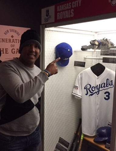 Salvador Perez points to his glove from the 2015 World Series that is on display in the Royals locker at the Hall of Fame. (Bill Francis/National Baseball Hall of Fame and Museum)