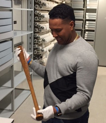 While touring the Hall of Fame on Nov. 10, Royals catcher Salvador Perez holds a game-used Ted Williams bat. (Bill Francis/National Baseball Hall of Fame and Museum)