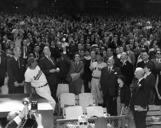 Washington Senators manager Ted Williams (left) and Commissioner Bowie Kuhn (second to left) watch as President Richard Nixon delivers a pitch before the Washington Senators' season opener against the New York Yankees on April 7, 1969. BL-400-81 (National Baseball Hall of Fame Library)