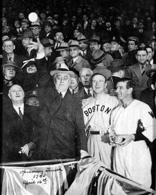 """President Franklin Roosevelt throws out the first pitch before an Opening Day game between the Red Sox and Senators at Griffith Stadium in April 16, 1940. Two years later, Roosevelt would author the """"Green Light Letter"""" that would preserve baseball during World War II. (National Baseball Hall of Fame and Museum)"""