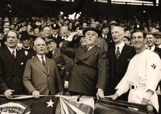 President Franklin Roosevelt with Clark Griffith,Connie Mack and Bucky Harris throwing out the ceremonial first pitch. BL-3883.74 (National Baseball Hall of Fame Library)
