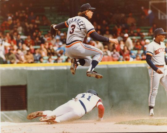 Tigers shortstop Alan Trammell leaping in the air to avoid a collision with the base runner sliding into second base. (National Baseball Hall of Fame and Museum)