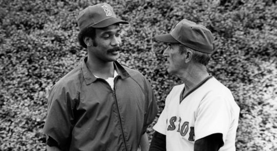 Jim Rice chats with Red Sox coach Johnny Pesky. In 1978, Rice won the American League's Most Valuable Player Award after a season in which he compiled 406 total bases. (National Baseball Hall of Fame and Museum)