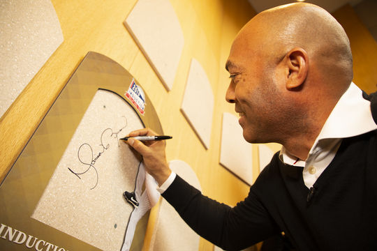 Hall of Fame Class of 2019 member Mariano Rivera signs his name on his plaque backer during his Orientation Visit. (Milo Stewart Jr./National Baseball Hall of Fame and Museum)