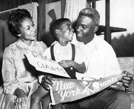 Jackie Robinson of the Dodgers with his wife, Rachel, and son David at their home in Stamford, CT after learning that Jackie had been traded to the New York Giants. BL-1831-72 (National Baseball Hall of Fame Library)