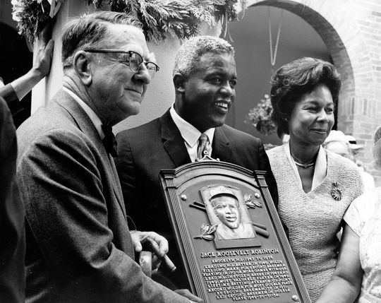 Jackie Robinson (center) holds his Hall of Fame plaque with his wife Rachel and future Hall of Fame executive Branch Rickey during the 1962 Hall of Fame Weekend. (National Baseball Hall of Fame Library)