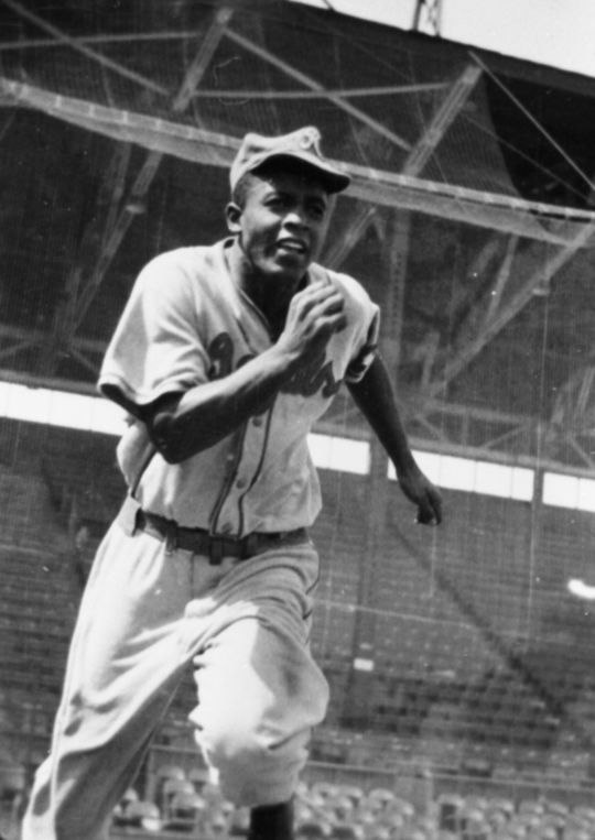 Jackie Robinson runs to first base in his Kansas City Royals uniform, worn during his tryout for the Brooklyn Dodgers. (National Baseball Hall of Fame and Museum)