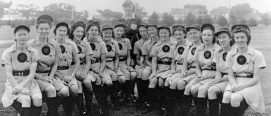 The 1943 All-American Girls Professional Baseball League All-Star Game featured a matchup of the Rockford (pictured above) and South Bend teams against the Racine and Kenosha teams. The game was played at Wrigley Field using portable lights on July 1, 1943, making it the first night game in the history of Wrigley Field. (National Baseball Hall of Fame and Museum)