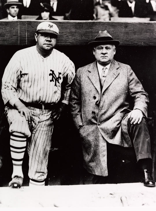 "Babe Ruth (pictured left) poses with manager John McGraw before taking the field for the New York Giants for a charity benefit game against the Baltimore Orioles on Oct. 3, 1923. (National Baseball Hall of Fame and Museum) <a href=""https://collection.baseballhall.org/islandora/object/islandora%3A611028"">PASTIME</a>"