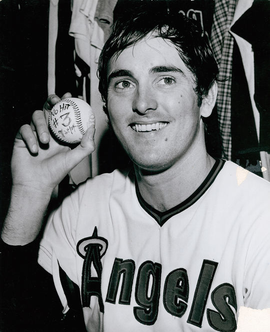Nolan Ryan, pictured after throwing his third career no-hitter, holds a baseball he used during the game. (National Baseball Hall of Fame)