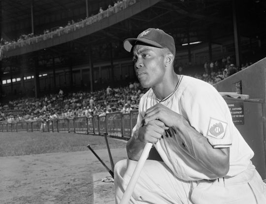 Monte Irvin of the New York Giants looks on from the dugout. (Osvaldo Salas / National Baseball Hall of Fame Library)