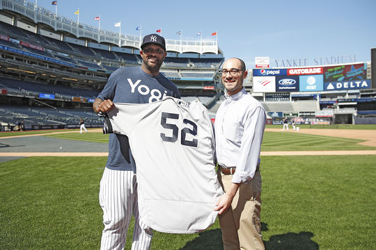 CC Sabathia of the Yankees donates a jersey to Hall of Fame vice president of communications and education Jon Shestakofsky on May 7, 2019. Sabathia wore the jersey during the game when he recorded his 3,000th career strikeout. (Barrie Schneiderman/New York Yankees)