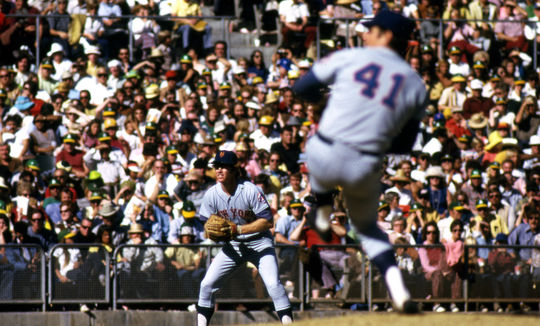 Tom Seaver of the Mets delivers a pitch during the 1973 World Series with teammate Wayne Garrett in the background. After the season, Seaver would be named the National League's Cy Young Award winner. (National Baseball Hall of Fame and Museum)
