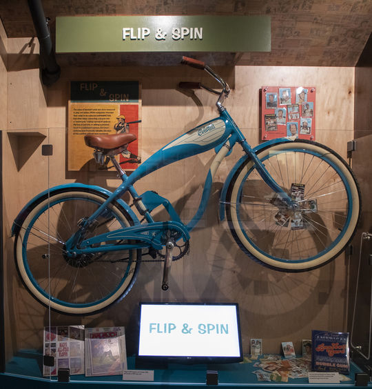 Millions of baseball cards ended up attached to bicycles over the years to produce a motorcycle-like noise when they smacked against the spokes of the bike's wheel. Visitors to the Hall of Fame's <em>Shoebox Treasures</em> exhibit can relive this experience with an interactive display. (Milo Stewart Jr./National Baseball Hall of Fame and Museum)