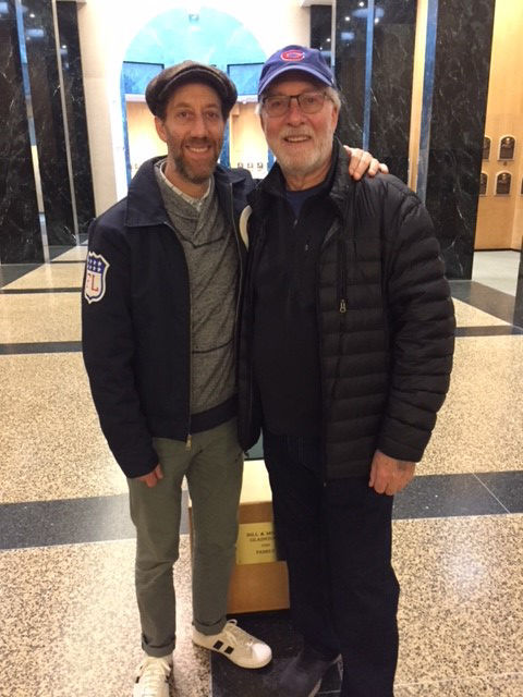 Actor Joey Slotnick, left, and his father Terry visited the Hall of Fame Oct. 17. Slotnick was featured in the 1992 film <em>A League of Their Own</em>. (Bill Francis/National Baseball Hall of Fame and Museum)
