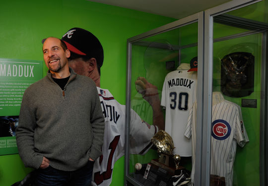John Smoltz checks out the Inductee exhibit for former teammate and Class of 2014 Inductee Greg Maddux. (Milo Stewart, Jr. / National Baseball Hall of Fame)
