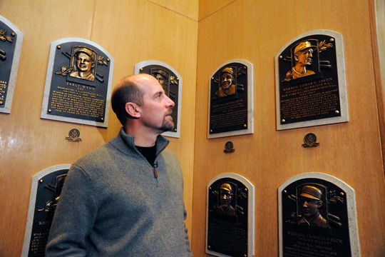 John Smoltz stops by the Hall of Fame plaque of another Braves Hall of Famer, Warren Spahn. (Milo Stewart, Jr. / National Baseball Hall of Fame)