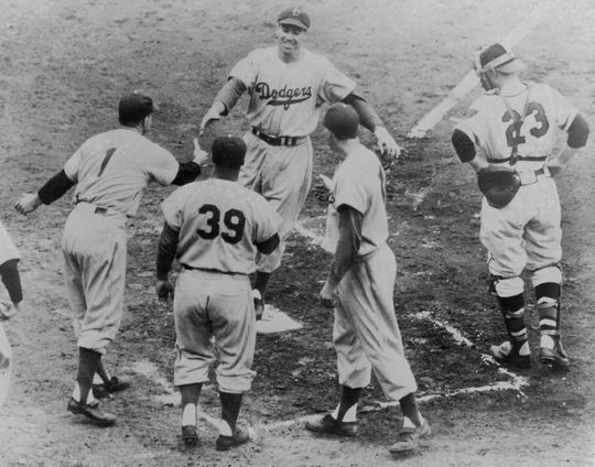 Duke Snider crosses home after hitting a home run in the 3rd inning in a September 30, 1949 game. BL-579.80