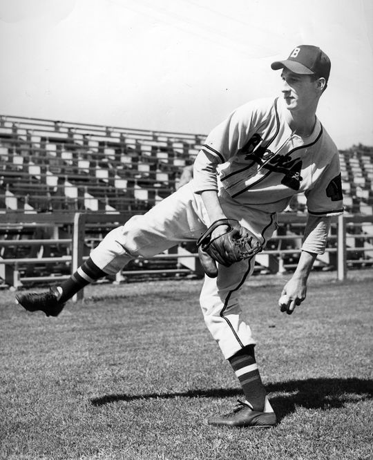 Warren Spahn was known for his high-kicking pitching motion, pictured above when he was playing for the Boston Braves. (National Baseball Hall of Fame and Museum)