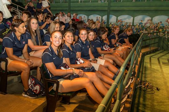 Members of the U.S. national women's baseball team and the Madonna Stars of Japan watched <em>The Baseball Experience</em> film in the Museum's Grandstand Theater. (Parker Fish / National Baseball Hall of Fame)