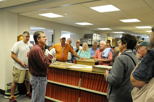 Participants in the VIP Experience receive a special tour of the Library Archive with Museum Librarian Jim Gates. (Milo Stewart, Jr. / National Baseball Hall of Fame)