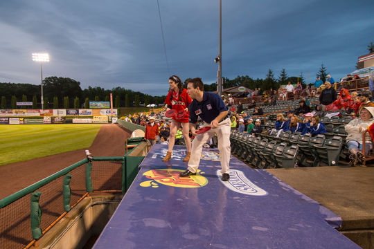 Travis Green, the 2015 multimedia intern in the Frank and Peggy Steele Internship Program at the National Baseball Hall of Fame and Museum participates in an in-game promotion during the Tri-City ValleyCats game. (Parker Fish / National Baseball Hall of Fame Library)