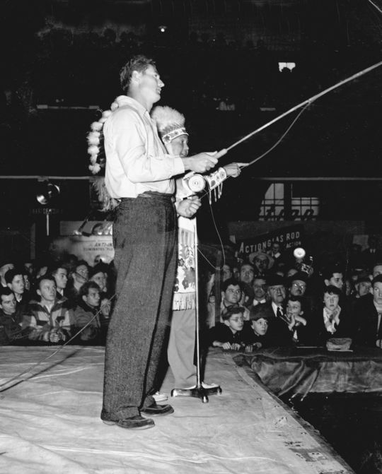 Hall of Famer Ted Williams entertains visitors with a fly fishing demonstration alongside Chief Needahbeh of the Maine Algonquin tribe at a National Sportsmen's Show. BL-1549-68 (National Baseball Hall of Fame Library)