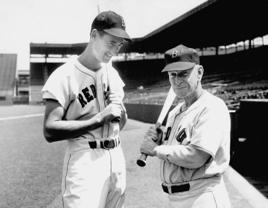 Ted Williams (left) and Hugh Duffy, both future Hall of Famers, pose during Williams' early days with the Red Sox. Duffy hit .440 with Boston's National League team in 1894, and Williams hit .406 with the Red Sox in 1941. (National Baseball Hall of Fame and Museum)