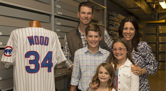 Kerry Wood and his family, including his wife Sarah, son Justin and daughters Katie and Charlie, visited the Hall of Fame on Friday, June 15. As part of their tour, the Woods got to see the jersey Kerry wore during his 20-strikeout game on May 6, 1998. (Milo Stewart Jr./National Baseball Hall of Fame and Museum)