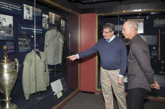 Hall of Fame Vice President of Exhibitions and Collections Erik Strohl shows Alan Trammell a sweater worn by Ty Cobb during Trammell's Orientation Visit on March 15. (Milo Stewart Jr./National Baseball Hall of Fame and Museum)