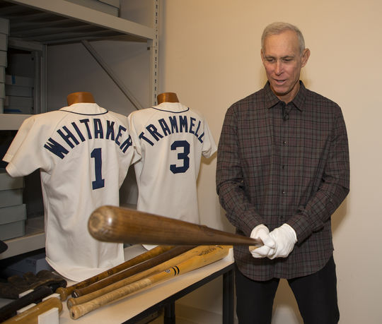 Alan Trammell holds a Babe Ruth bat during his tour of the Museum's collections area on March 15. (Milo Stewart Jr./National Baseball Hall of Fame and Museum)