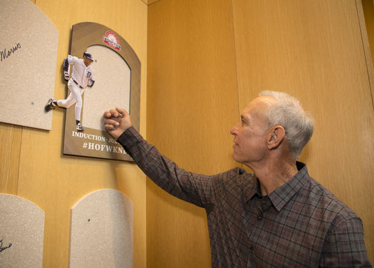 Alan Trammell touches the spot where his Hall of Fame plaque will hang following his July 29 induction. (Milo Stewart Jr./National Baseball Hall of Fame and Museum)