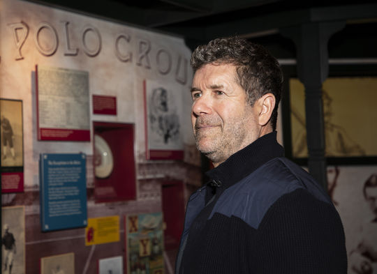 Edgar Martinez pauses to examine the Museum's <em>Taking the Field</em> exhibit during his Orientation Visit to the Hall of Fame on April 8, 2019. (Milo Stewart Jr./National Baseball Hall of Fame and Museum)