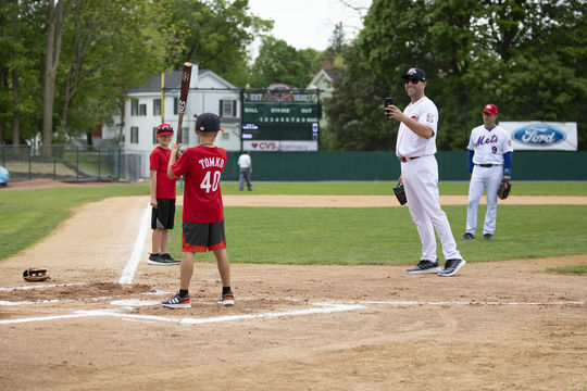 Brett Tomko takes a photograph of one of his sons at Doubleday Field during the 2019 Hall of Fame Classic. (Milo Stewart Jr./National Baseball Hall of Fame and Museum)
