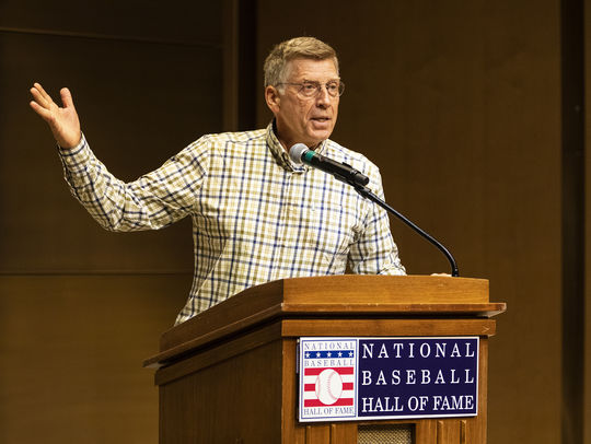 Bob Santelli, the keynote speaker for the 2019 Cooperstown Symposium on Baseball and American Culture, speaks to a packed house in the Museum's Grandstand Theater on May 29. (Milo Stewart Jr./National Baseball Hall of Fame and Museum)