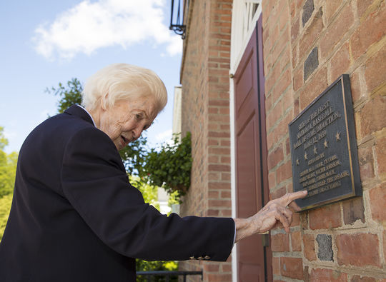 Betty Roxborough reads a plaque commemorating the first Hall of Fame Induction in 1939. She was 13-years-old at the time, and still has vivid memories of that day. (Milo Stewart Jr. / National Baseball Hall of Fame and Museum)