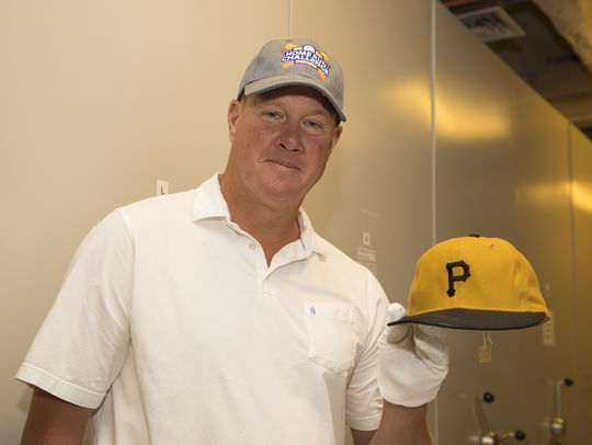 Jim Abbott holds Roberto Clemente's 3,000th hit cap during his visit to the Hall of Fame. (Milo Stewart Jr./National Baseball Hall of Fame and Museum)