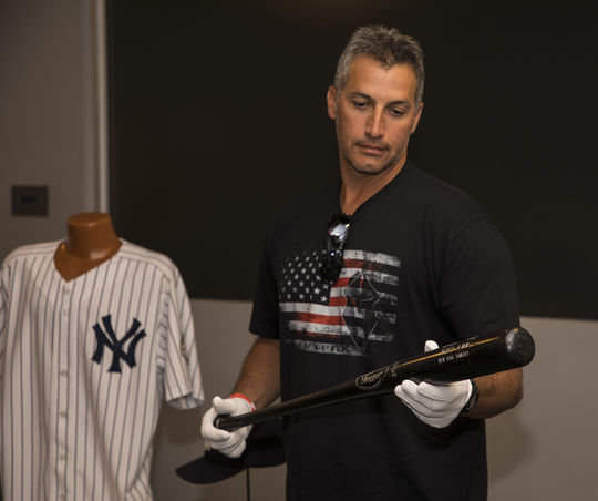 Andy Pettitte holds Derek Jeter's bat used during the 1998 World Series. Pettitte won his only start of that World Series, helping the Yankees capture their second Fall Classic title in three seasons. (Milo Stewart Jr. / National Baseball Hall of Fame and Museum)