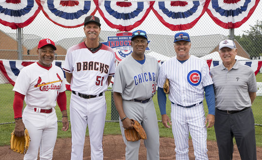 Hall of Famers (from left) Ozzie Smith, Randy Johnson, Fergie Jenkins, Ryne Sandberg and Pat Gillick got Hall of Fame Weekend under way on Friday at Ozzie's PLAY Ball event in Cooperstown. (Milo Stewart Jr./National Baseball Hall of Fame and Museum)