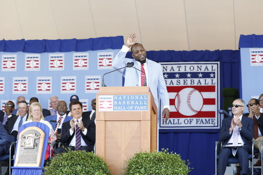 Vladimir Guerrero waves to the crowd after delivering his Induction Speech. Many fans traveled from the Dominican Republic to see the Dominican-born Guerrero. (Milo Stewart Jr./National Baseball Hall of Fame and Museum)