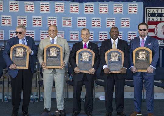 (From left to right): Bud Selig, Iván Rodríguez, John Schuerholz, Tim Raines and Jeff Bagwell pose with their bronze plaques following the 2017 <em>Induction Ceremony</em>. (Milo Stewart Jr. / National Baseball Hall of Fame and Museum)