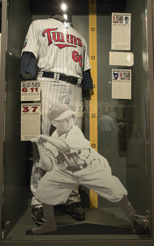 This cut out of the 3-foot-7 Eddie Gaedel is juxtaposed next to the uniform of 6-foot-11 pitcher Jon Rauch, the tallest player in major league history, in the One for the Books exhibit on the Museum's third floor. (Milo Stewart, Jr. / National Baseball Hall of Fame and Museum)