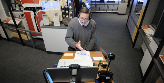 Hall of Fame manager of digital and outreach learning, Bruce Markusen, connects with a classroom in the Museum's <em>One for the Books</em> exhibit. (Milo Stewart, Jr. / National Baseball Hall of Fame)