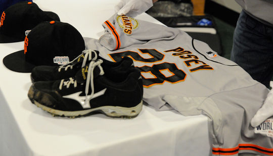 Artifacts from the San Francisco Giants are prepared for an artifact spotlight. (Milo Stewart, Jr. / National Baseball Hall of Fame)