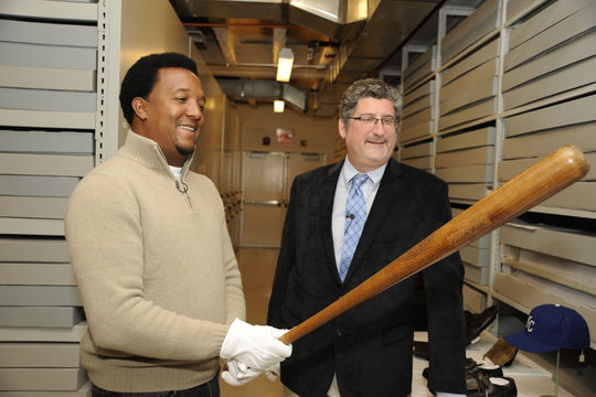 Hall of Fame vice president of exhibitions and collections Erik Strohl shows Pedro Martinez a Babe Ruth bat during Martinez's Hall of Fame Orientation Tour on Feb. 27. (Milo Stewart, Jr. / National Baseball Hall of Fame)