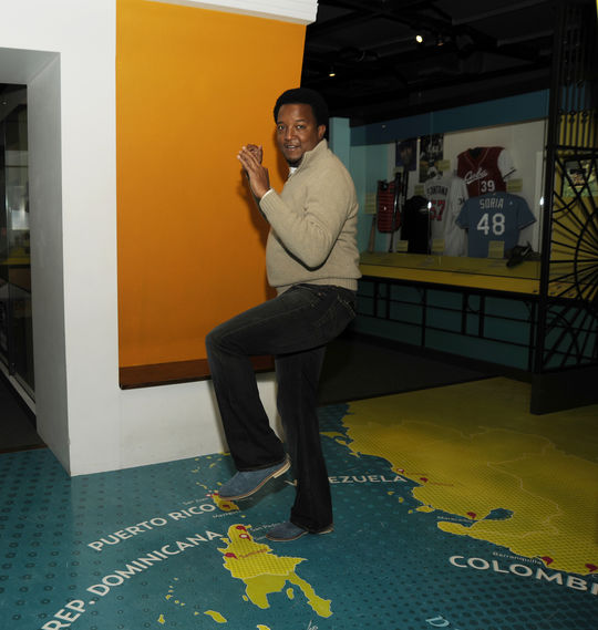 Pedro Martinez locates his hometown in the Dominican Republic in the Hall of Fame's Viva Baseball exhibit. (Milo Stewart, Jr. / National Baseball Hall of Fame)