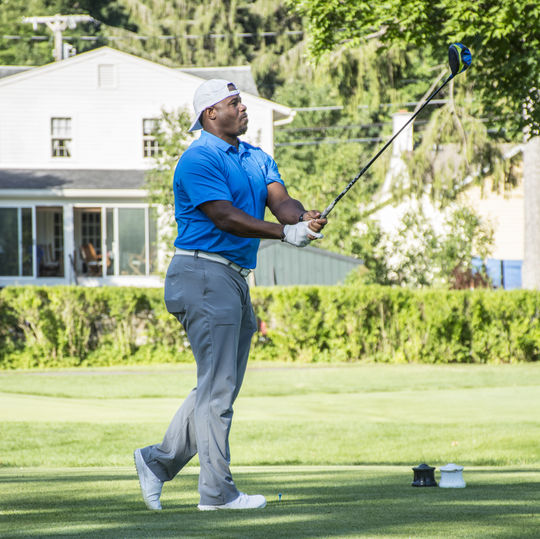 Hall of Fame Class of 2016 member Ken Griffey Jr. follows through on his golf swing at the Otesaga Hotel and Resort Saturday morning. (Milo Stewart / National Baseball Hall of Fame)