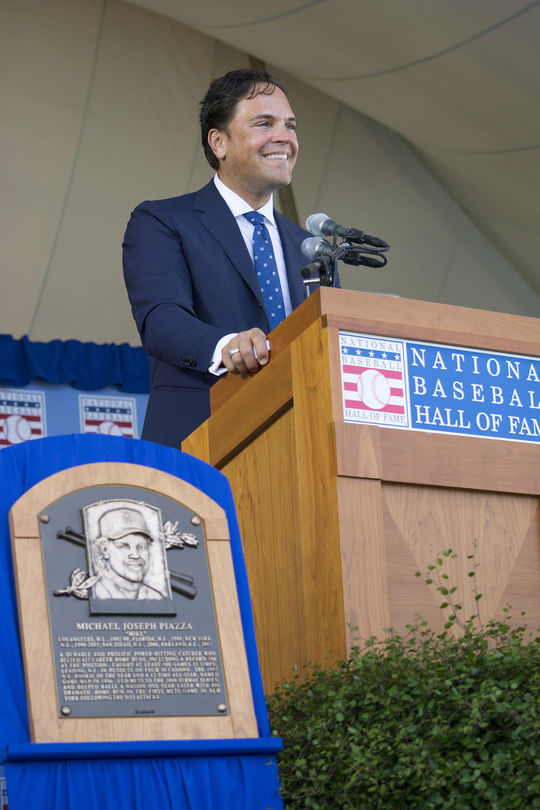 """Mike Piazza, addressing the hoards of Mets fans who had come to witness his historic induction, said that """"no fans rock the house like Mets fans."""" (Milo Stewart Jr. / National Baseball Hall of Fame)"""