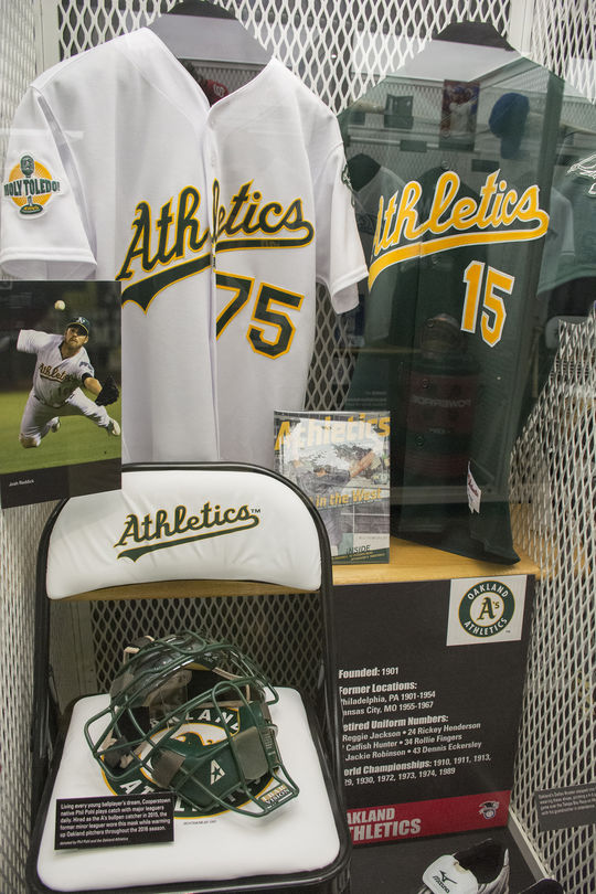 This A's locker in the Hall of Fame now features a catchers mask worn by Cooperstown High School alumnus Phil Pohl, who is a bullpen catcher for the A's. (Milo Stewart Jr. / National Baseball Hall of Fame)