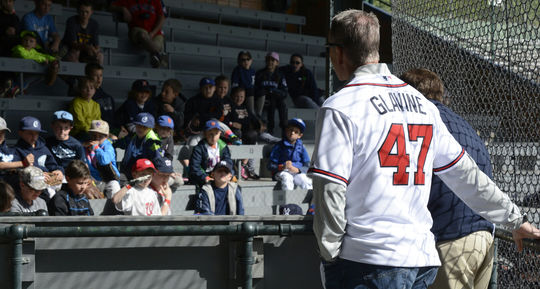 Tom Glavine, who was elected to the Hall of Fame in 2014 after a 22-year big league career, shares some wisdom with kids at the Cooperstown Classic Clinic at Doubleday Field on May 22. (Milo Stewart, Jr. / National Baseball Hall of Fame)